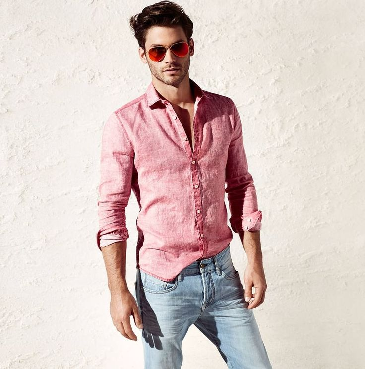 Casual pink shirt with faded denim jeans