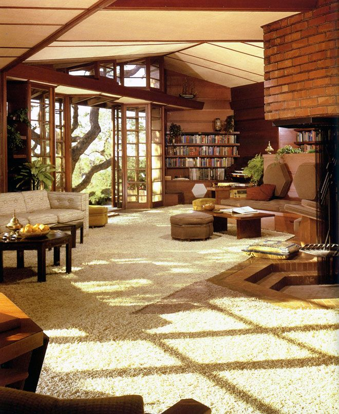 Wow. I'm always amazed by Frank Lloyd Wright, (obviously Fallingwater, and Price Tower in my grandparents old haunt), but this is amazing. Seriously. Just look at it for awhile. Look at those doors and that huge tree view. Look at the lighting this room gets. Look at that wonderfully kitchy decoration and furniture! I want it all!