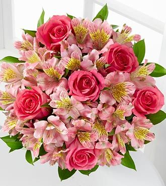 Dreamland Pink Bouquet | FTD -- brilliant pink roses sit amongst a cloud of pink Peruvian Lilies