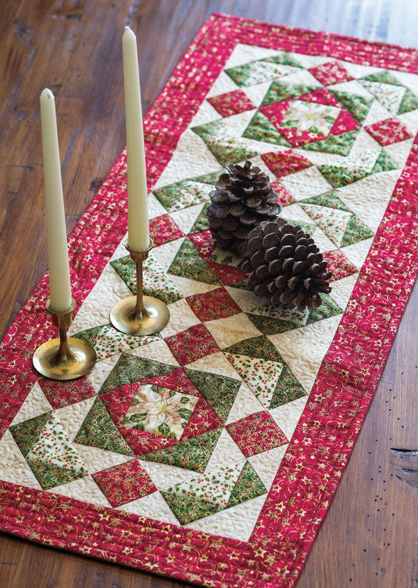 Let this table runner set the stage for your holiday entertaining. Metallic prints add a little extra sparkle. Flying geese units and square units surround each quilt block with fussy cut poinsettia print centers.