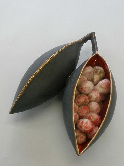 Pod with felted seeds. Collaborative work. Ceramics by Lucie Berben. Feltwork by Janine Berben. janine berben/flickr photostream.