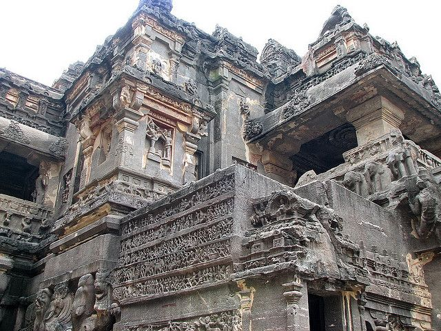 Another view of KailashTemple's exterior at Ellora Caves. Ellora is an ancient village 30 km (18.6 miles) from the city of Aurangabad in the Indian state of Maharashtra. Famous for its monumental caves, Ellora is a World Heritage Site. Ellora represents the epitome of Indian rock cut architecture. The 34-caves are actually structures excavated out of the vertical face of the Charanandri hills. Buddhist, Hindu and Jain cave-temples and monasteries show us religious tolerance and co-existence.