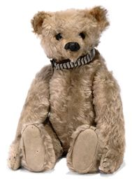A STEIFF ROD BEAR, (28PB), jointed with metal rods, blonde mohair, black boot button eyes, gutta percha nose, pink stitching under nose, seam from ear to ear, black stitched claws, elephant button and steel and leather collar, <I>circa 1904 --15in. (38cm.) high (bald areas down right arm and left leg, some other wear and fading)</I>; and an x-ray of the internal joints