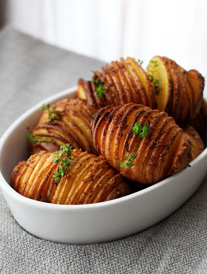 How to Make Hasselback Potatoes....I could totally imagine this with sweet potatoes, too!