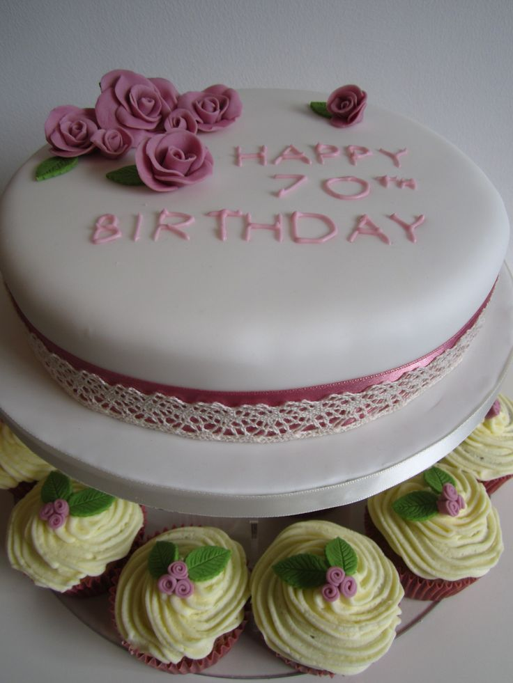 Floral birthday cake and cupcakes