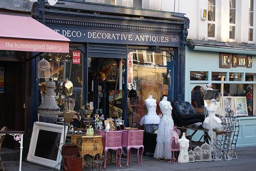 Portobello Road market. Saturday morning in London. The Notting Hill tube is at one end of the street. We had a taxi drop us off at the other end. Love the antique print shop. Get there at 9!