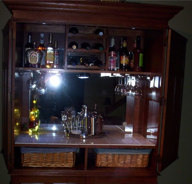 Converted a TV amoire into a bar/liquor cabinet