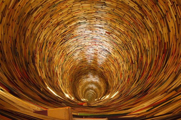 The infinite book tunnel in Prague's Library  http://www.youtube.com/watch?v=xveVDyedISw