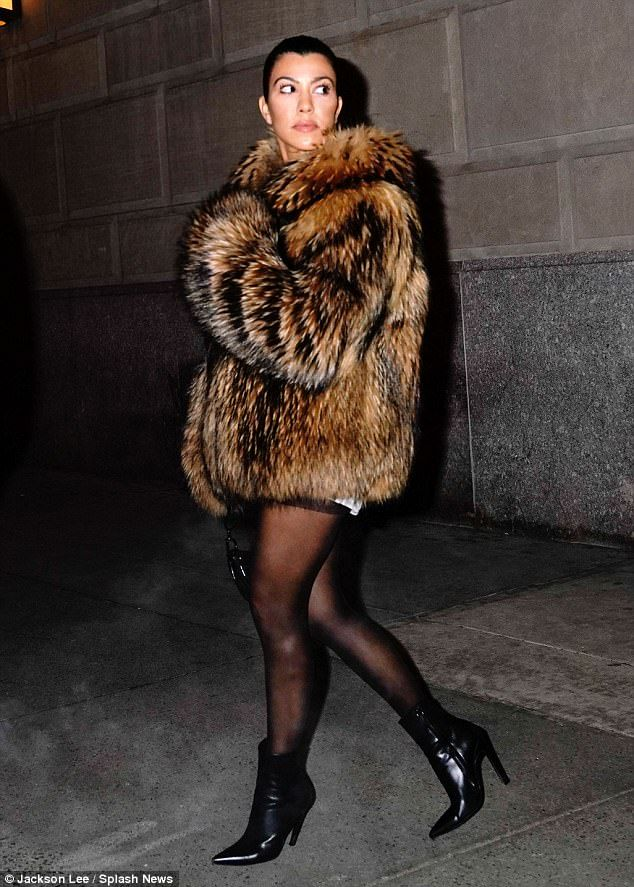 Fashionista: The 38-year-oldoozed of Big Apple chic as she sported a large brown fur coat while showing off her legs in black pantyhose with matching leather ankle booties