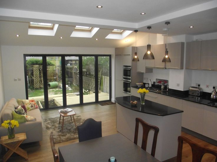 Another reasonable overview of what we want. Kitchen are with island (like the pendant lights over island) with ceiling lights throughout room, with dining area and seating area. Think we want tiled floor though with under floor heating, not wood.