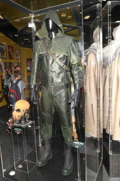 This is Stephen Amell's screen used costume from Arrow as seen at San Diego Comic-Con 2012. These photos also include Arrow's bow and the DeathStroke Mask.