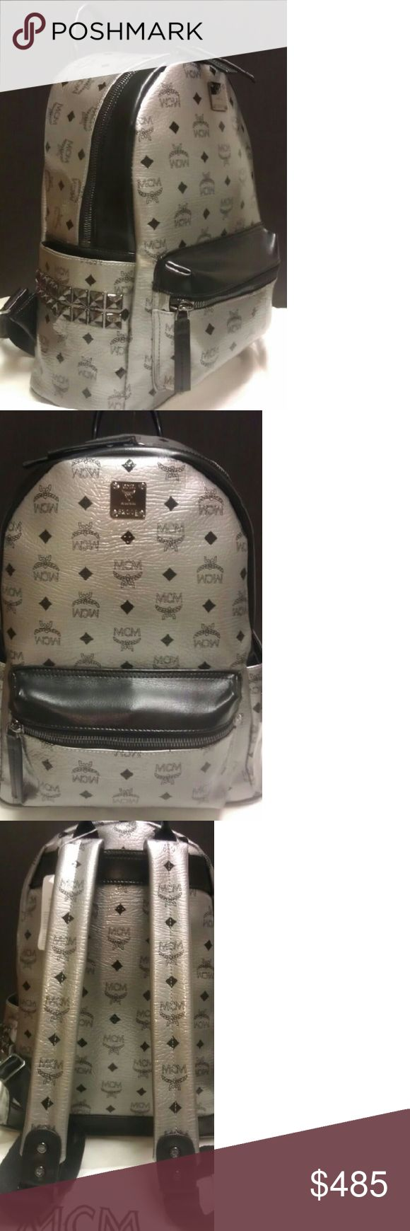 "MCM Mettalic Grey & Black studded Medium Backpack Excellent New condition MCM Mettalic Grey & Black studded Medium size Backpack. Price is Firm  ?11"" tablet laptop compartment ?cell phone pockets ?2 side pockets ?1 inside zipped pocket ?large cabin space ?1 outer zipped pocket ?MCM dust bag included MCM Bags Backpacks"