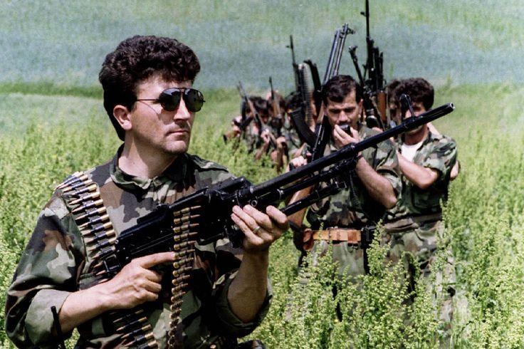 Bosnian Serb soldiers advancing through a field 1993