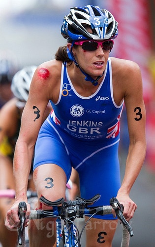 Helen Jenkins carries on after a crash during the women's ITU World Championship Series triathlon in Sydney, Australia