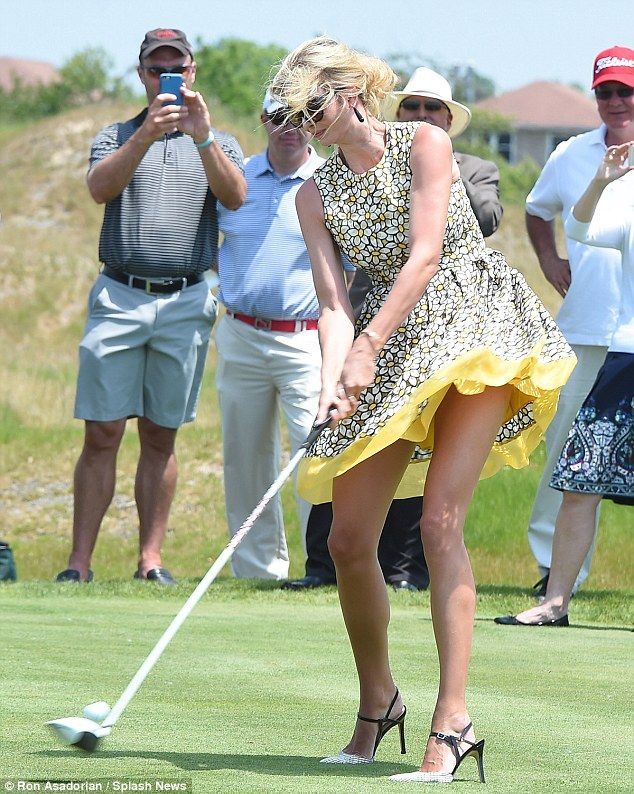 Showing them how it's done: Ivanka showed off her trim legs in the yellow frock which featured a daisy print