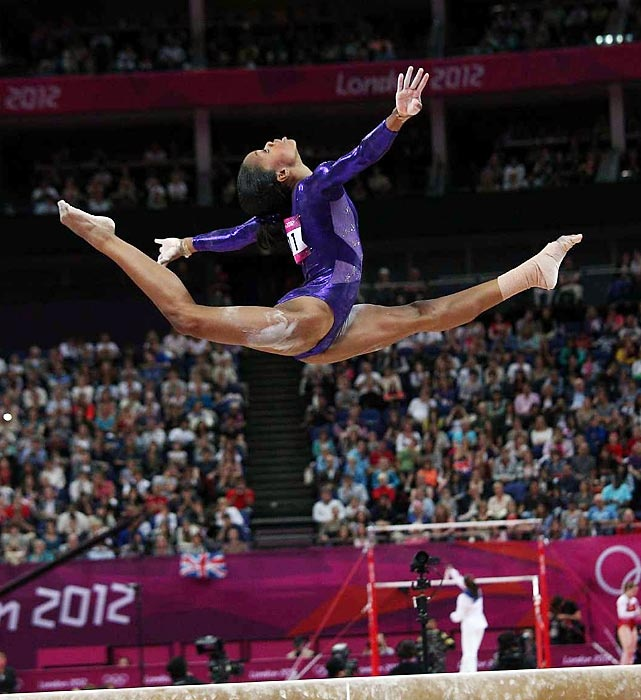 American gymnast Gabby Douglas performing split leap on balance beam at 2012 Summer Olympics in London, England.