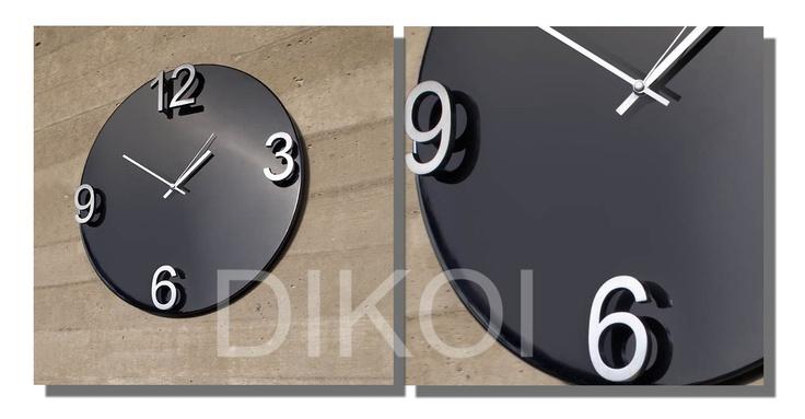 Wandklok Elapse . Afmeting : Ø 47CM.  Materiaal: Hout en metaal  Prijs: € 99,95