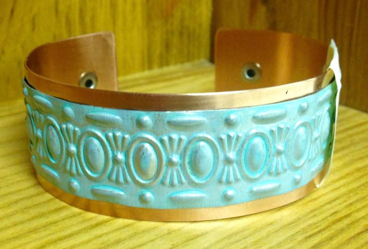 Hand forged cuff with copper and vintage style tin.  $30 From: www.facebook.com/stashbug