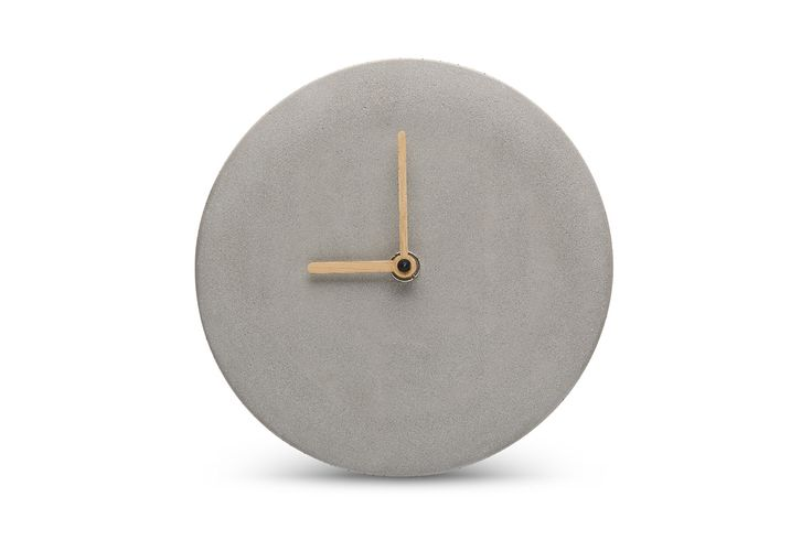 Concrete and bamboo come nicely together in this contemporary wall clock. Designed by Sean Yu & Yiting Cheng
