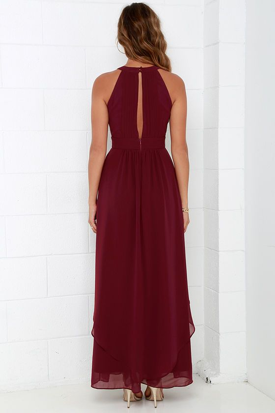 When you're dreaming about the Dream Girl Wine Red Maxi Dress you won't want to wake up! Elegant chiffon in a lovely wine red hue shapes a high, halter neckline above a sleeveless pin-tucked bodice embellished by a front keyhole. Panels of chiffon flutter atop the sweeping maxi skirt as it falls effortlessly from a fitted, empire waist. Back keyhole has two-button closure. Hidden zipper/hook clasp at back. Fully lined. Self: 100% Polyester. Lining: 95% Polyester, 5% Spandex. Dry Clean Only.
