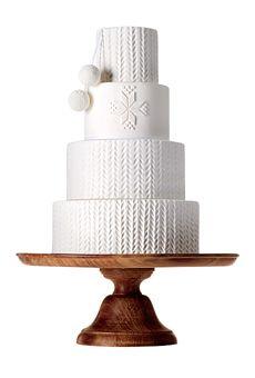 Um bolo de casamento de Inverno de quatro níveis |  Bolo de casamento