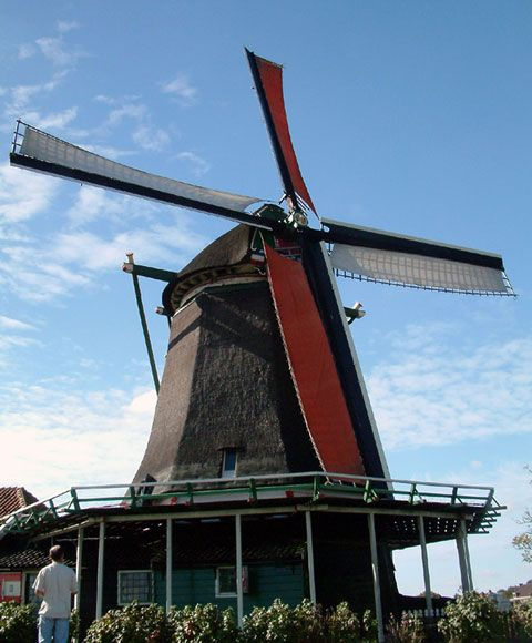 This is a Dutch windmill. A long time ago they were used to mill grain or to pump water from one side of the dike to the other. By pumping water from one side of the dike to the other they created more land, where they can build houses and grow vegetables.  The wind mill is a typical dutch symbol for me, because I have never seen a wind mill like this in another country. That is why a Dutch wind mill gives mee a feeling of being home. (Kevin Ewalds)