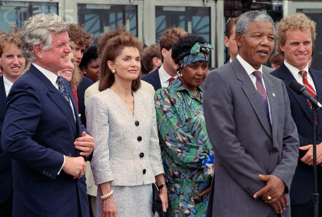 Anti-apartheid activist Nelson Mandela meets with members of the Kennedy family in Boston during a 1990 tour of the United States following his release from a South African prison. In front, from left to right, are Senator Ted Kennedy, Jacqueline Kennedy Onassis, Winnie Mandela, Nelson Mandela, and Congressman Joe Kennedy, 06/24/90.