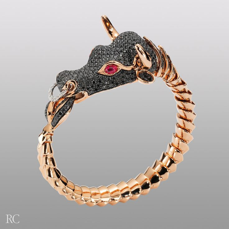 Bull bracelet in black sapphires and rose gold.  By Roberto Coin.