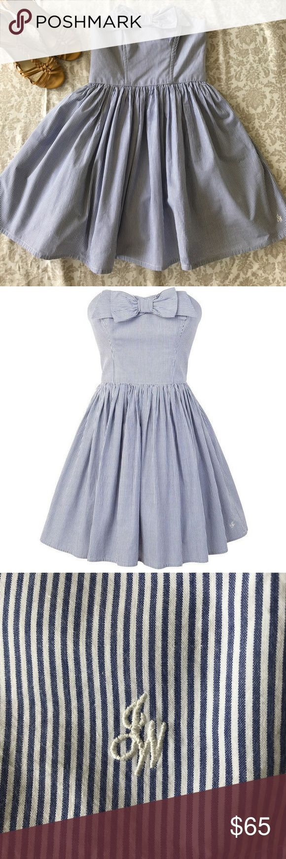 Jack Wills Hemsley Strapless Fine Stripe Bow Dress Whatever you have planned, the Hemsley dress is perfect for all your summer occasions. This strapless style has a cute bow at the neckline, boning in both front and back of bodice, 2 pockets, gathering at waist, and invisible back zipper with hook/eye closure. A ruffled white slip is attached and gives the skirt more body. Very slight discoloration shown in pictures. So well made! Jack Wills Dresses Strapless