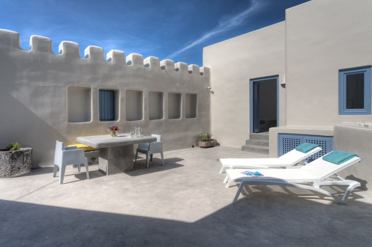 private villa, pyrgos, santorini, old canava, outdoor, built in table, sunbeds, modern, colors