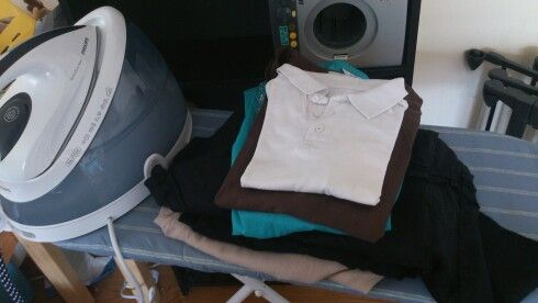 Ten minutes with Philips PerfectCare Iron and a lovely tidy bundle of clothes that look cared for (a novelty).