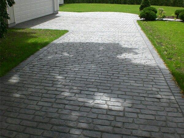 Istället för stenläggning på infart osv; gjut betong, pigmentera och prägla mönster.