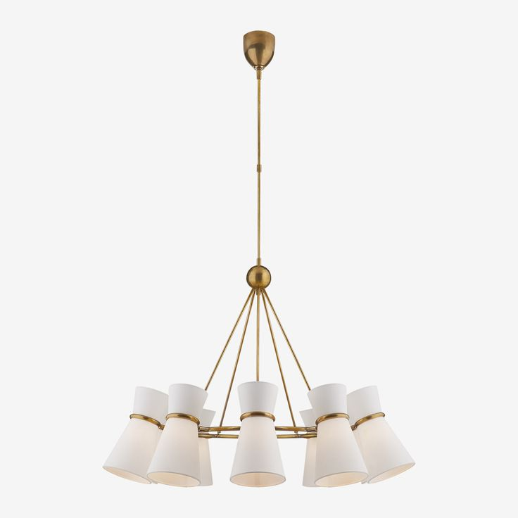 The Clarkson Chandelier in Hand-Rubbed Antique Brass with Linen Shades by AERIN • A mid-century modern inspired design, the Clarkson Chandelier brings a stylish look to a room. With its minimal yet elegant design, its ten angled linen shades bathe a space in light. As we've come to expect from AERIN, this Clarkson Chandelier displays a beautiful, delicate and contemporary aesthetic.