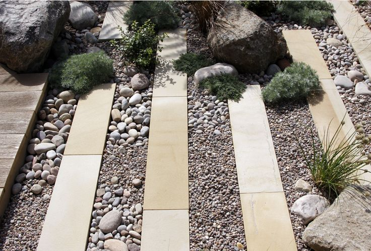 pebbles, boulders combined with sawn plank paving