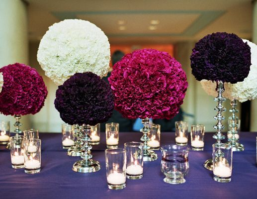 If you're not into hanging pomanders from chairs or the ceiling, ask your florist to set them atop candlesticks (it works for both vintage and modern styles) and arrange them on the tables for a not-often-seen look.