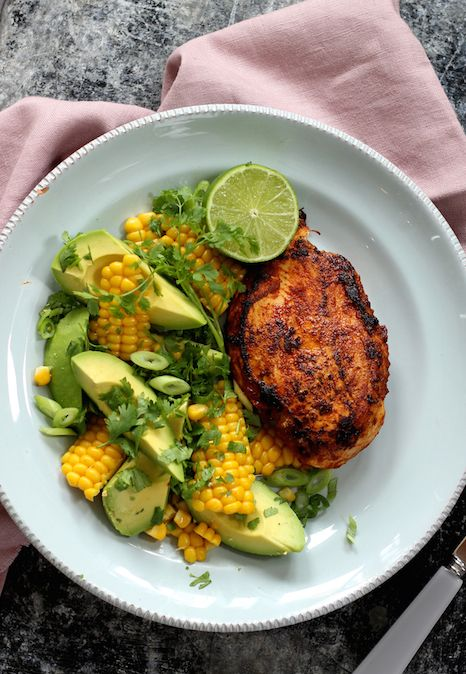 MEXICAN BBQ CHICKEN BREAST WITH AVOCADO, CORN & LIME. The lovely orange colour and mellow flavour of this barbecued skinless free range chicken comes from the simple rub we have mixed just for this dish. Served with avocado, corn kernels and lime to keep this super health and filling all at the same time.   30 Minutes. Gluten Free. Free Range Chicken. Winner.