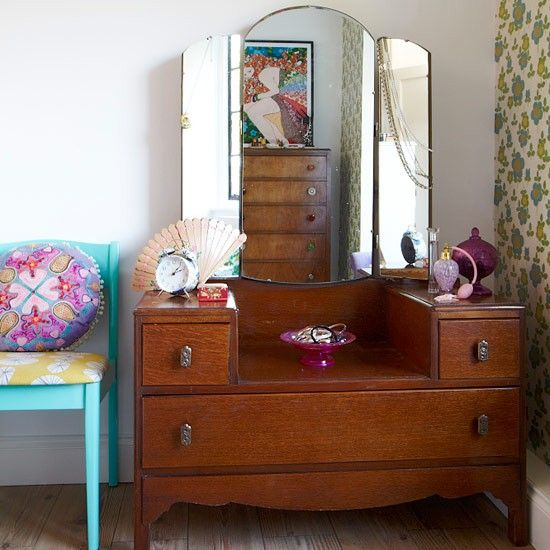 Ditch the chair and bring in the dresser with the mirror.  Beautiful!