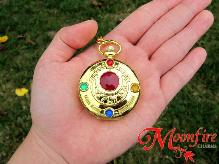 This Sailor Moon Crystal Transformation locket opens up to reveal a beautiful, intricate pocket watch! The gold-plated watch measures 4.5 cm in diameter. The gold-plated chain measures 30 inches.