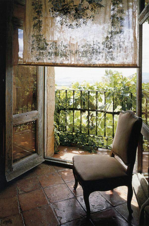 Window curtain. Doors. Floor. Chair. Balcony.