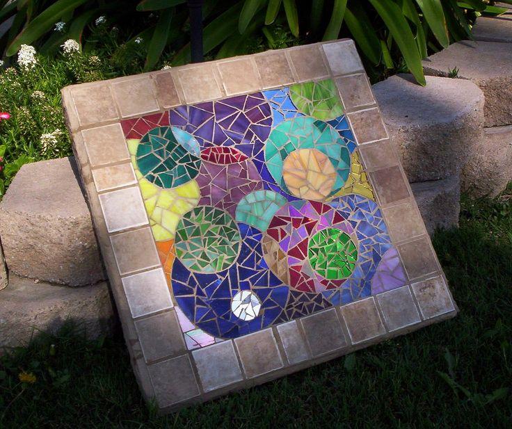Still pluggin along on my mosaic garden rug.  :)