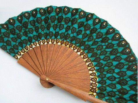 Wooden hand fan.