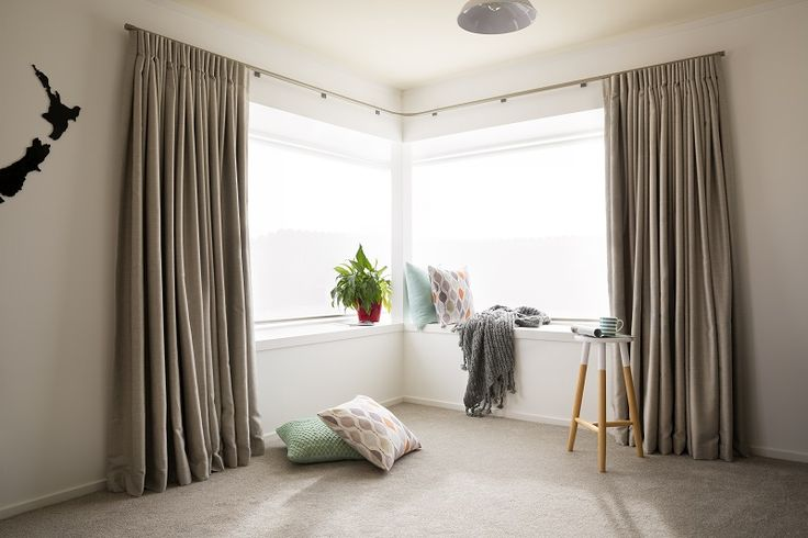 The final reveal! Natural coloured custom-made curtains in Sausalito, Ash colour by Warwick Fabrics, teams up with soft greige coloured carpet and a splash of orange and aqua in the accessories. Decorating products are available in New Zealand through Guthrie Bowron stores.