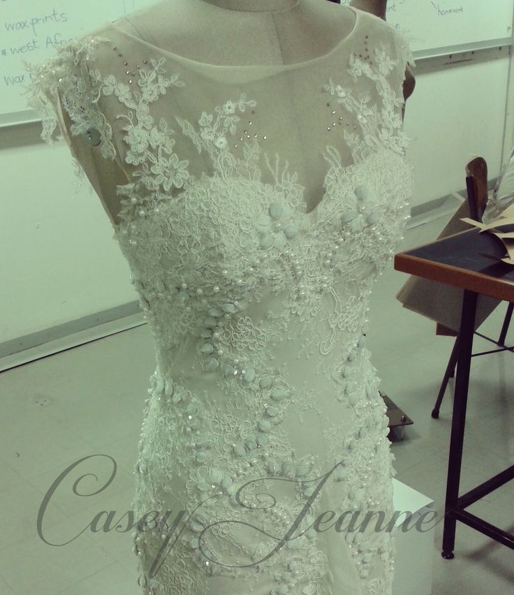 Wedding gown by designer Casey Jeanne, South Africa. Bodice created entirely by hand with four different beautiful laces <3 https://www.facebook.com/CaseyJeanneDesigns