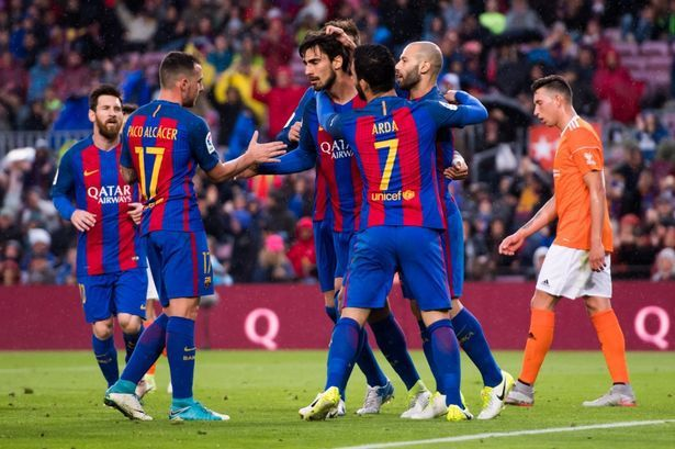 Barcelona thrashed Osasuna 7-1 in their fight to remain at top of Laliga