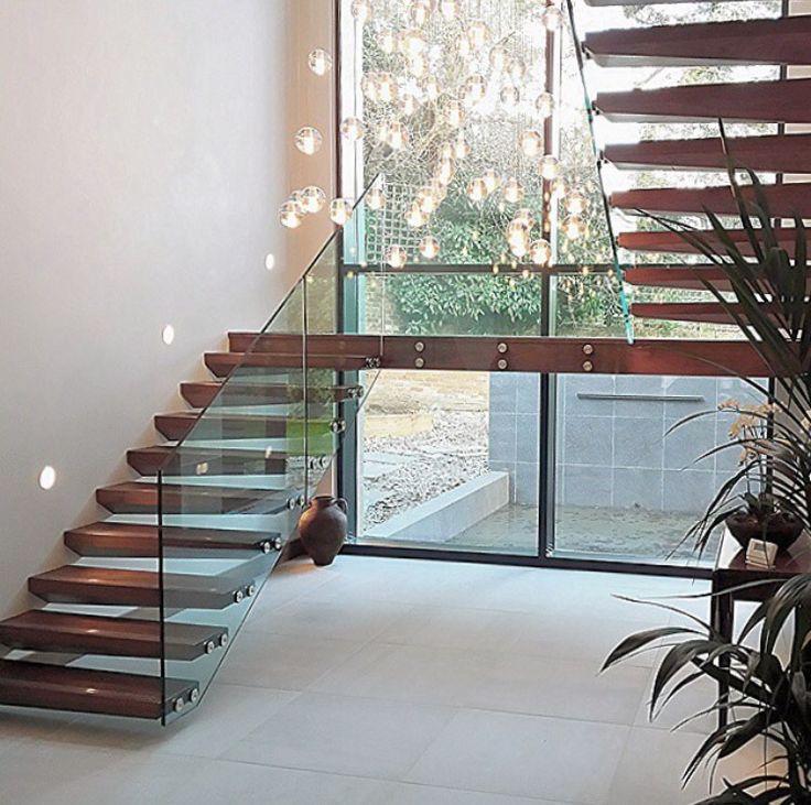 Frameless glass balustrades with open treads.