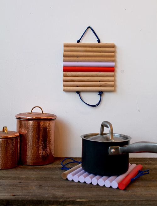 Leather-and-wood trivets that double as wall art. #DIY