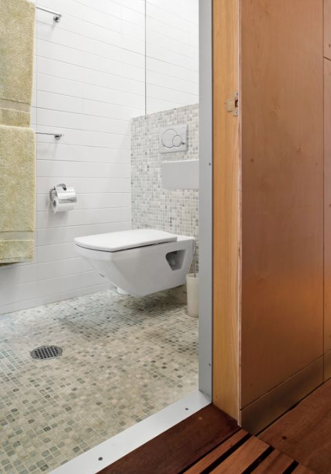 fully tiled bathroom - open shower