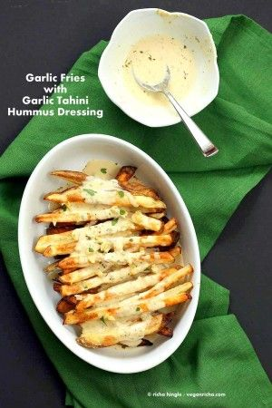 Baked Fries with Garlic Sauce and Oregano. Baked potato wedges served with garlic hummus tahini sauce & golden garlic. Garlic fries Vegan Gluten-free Soy-free Snack Recipe