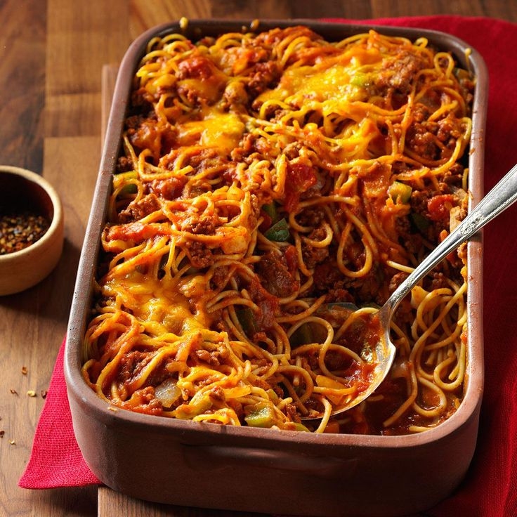 Confetti Spaghetti Recipe -It's not uncommon for folks to go back for second helpings of this hearty main dish when I share it at church potluck suppers. The combination of ground beef, noodles, cheese and a zippy tomato sauce is a crowd-pleaser. —Katherine Moss, Gaffney, South Carolina