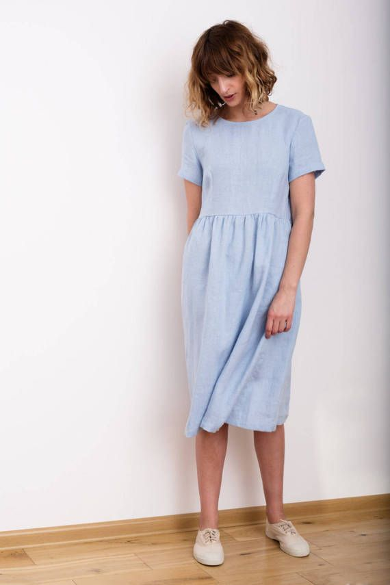 Sky blue linen short sleeve dress.  --------------------------------------------------------------------------------------------------------  ABOUT:  This handmade linen dress is very comfortable and feminine. Made from locally manufactured prewashed linen fabric and is perfect for all seasons. --------------------------------------------------------------------------------------------------------  DESCRIPTION:  -Silhouette- - slightly loose fit body with hand ruffled skirt - higher waist…